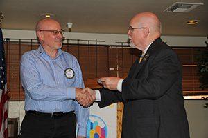 Bob Grady receives the Club Energizer Award from Governor Joe