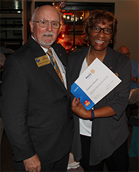 Past President Anita McDonald accepts club recognition from District 5500 for support of the Ride to End Polio