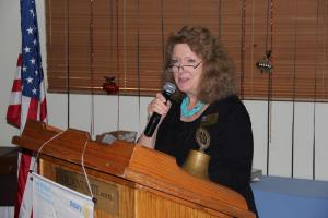 Assistant District Governor Ann Huber introduces Governor Joe